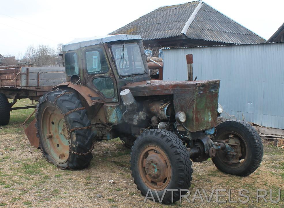 трактор с цепями